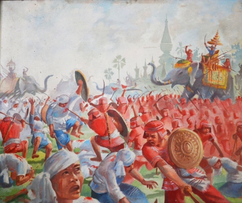 King Xayshethathirath leading the people in the fight against feudalist Burmese.