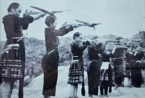 Hmong people undertake military training.