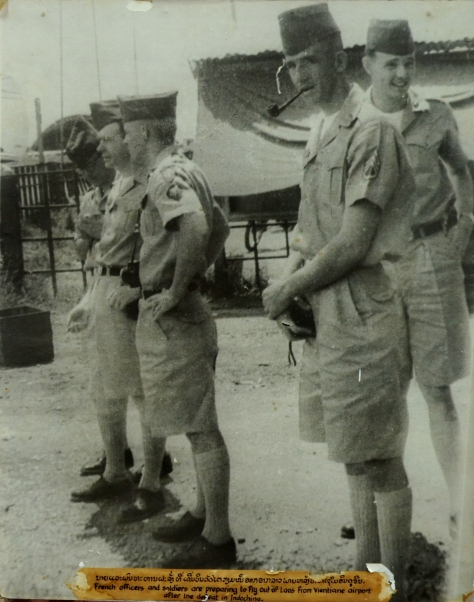 French officers and soldiers preparing to fly out of Laos from Vientiane Airport after the defeat in Indochina.