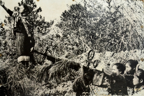 The women milita pack district of Xieng Khouang with 12.8mm machine gun in the KuKiet operation August 1969